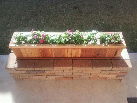 flower planter     brick walkway   home