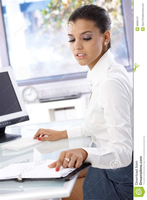 Office Worker At Desk Office Worker Sitting At Desk Royalty Free Stock Photography Image 28890747