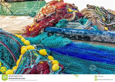 brightly colored fish brightly colored fish nets in a mediterranean port stock