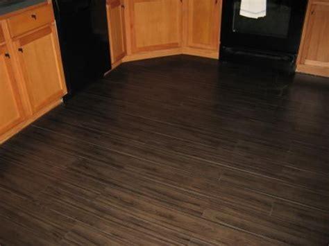 Trafficmaster Flooring by Trafficmaster 6 In X 36 In Iron Wood Luxury Vinyl