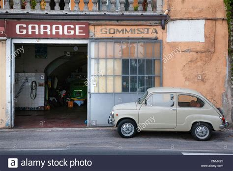 italian fiat parked outside a garage in italy stock
