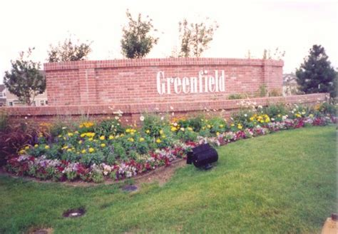 Landscape Design Around Signs Commercial And Residential Landscaping Walls Pavers