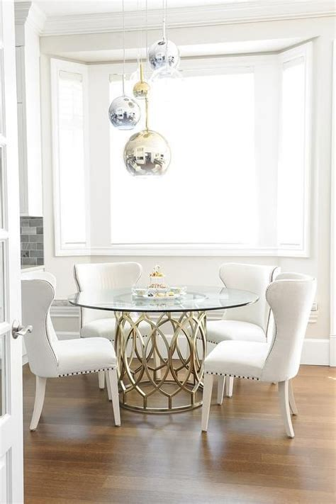gorgeous dining room features staggered brass glass