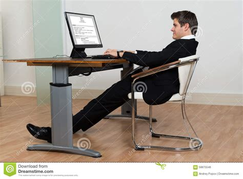 Leaning Back In Chair Posture by Businessman Leaning Back In His Chair While Working On