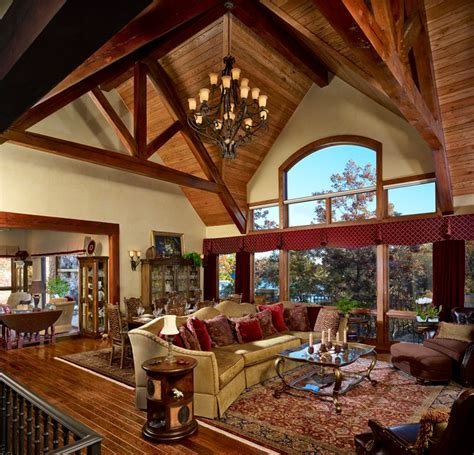 country great room with exposed beam by neal prince studio