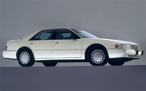 photos and videos 1997 cadillac seville sedan history in pictures kelley blue book future classic 1992 1997 cadillac seville motor trend