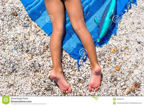 little legs closeup of little girl legs on tropical beach with stock