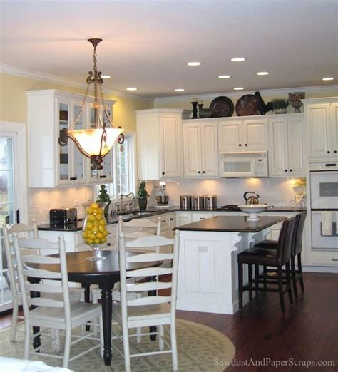 kitchen  white cabinets  black granite countertops