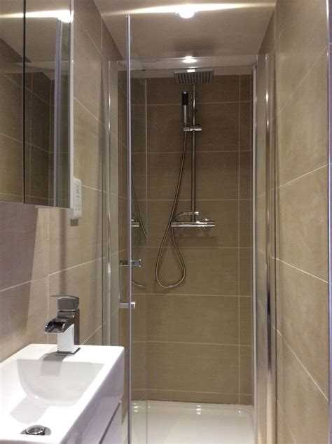the en suite shower room is fully tiled in porcelain and features a room shower