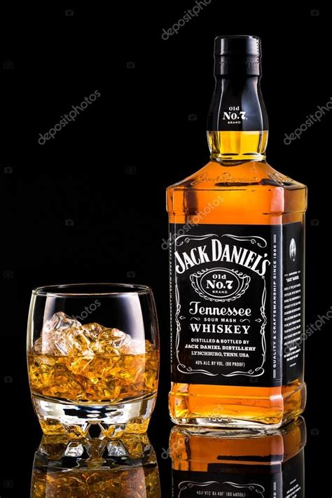whiskey photography daniel s whiskey bottle and glass stock editorial