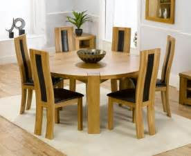 Deco oak large round dining table 160cm amp 6 santander chairs brown