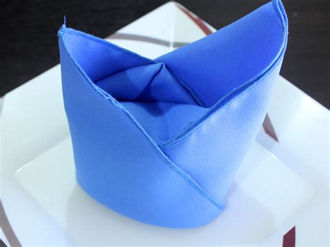Napkin Origami - how to fold a napkin into a bishops mitre 12 steps