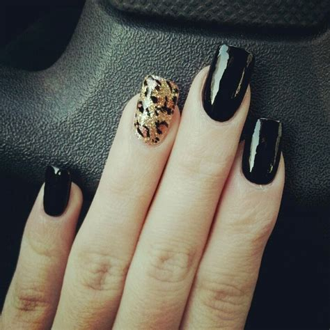 black finger with a ring black nails and glitter cheetah print ring finger nails