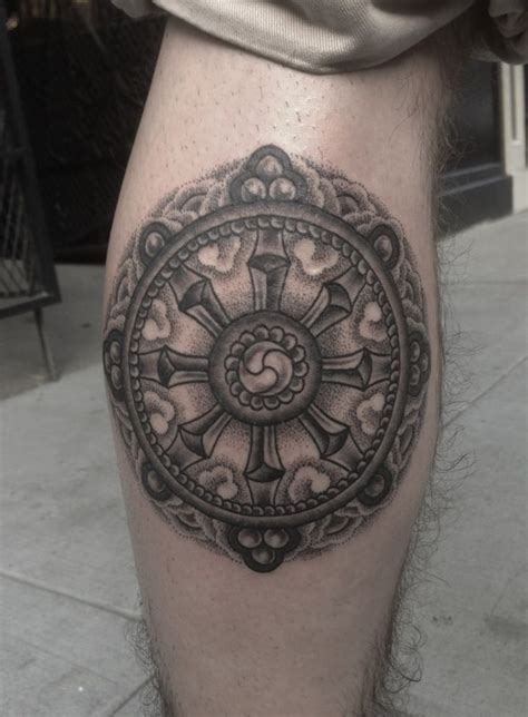 dharma wheel tattoo a beautiful dharma wheel representing the eight fold path