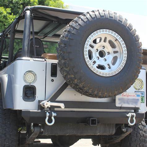 swing tire carrier 87 06 jeep wrangler yj tj rock crawler rear bumper tire