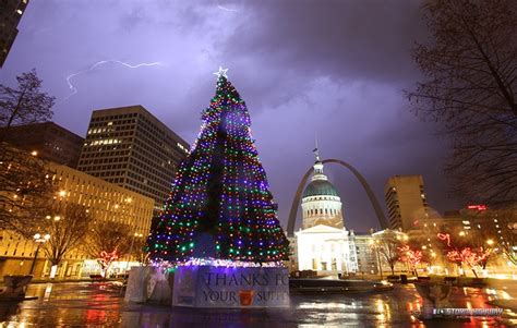 lightning with lit christmas tree in downtown st louis