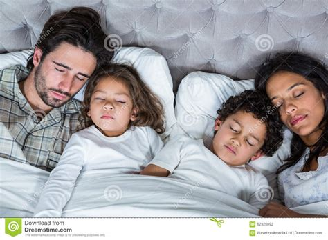 polygamist family sleeps in same bed happy family sleeping together stock photo image 62325892