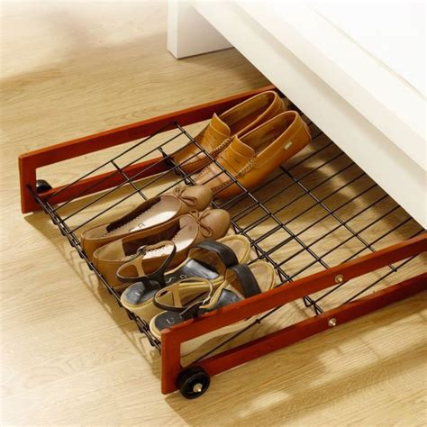 under the bed shoe rack caster black metal under bed shoes storage with small black wheels for rack and brass