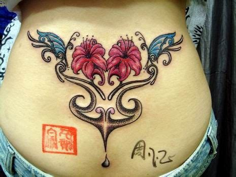 free tattoo designs lower back butterfly and flower tattoo