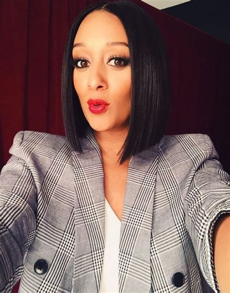 tia mowry long straight hair extensions hairstyle hot middle part asymmetrical bob tia hardrict make me over