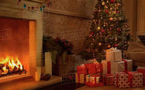 christmas tree  gifts  fireplace  living room stock photo dissolve