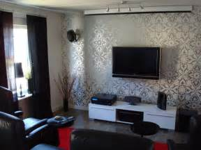 modern living room with carving wallpaper and tv setup