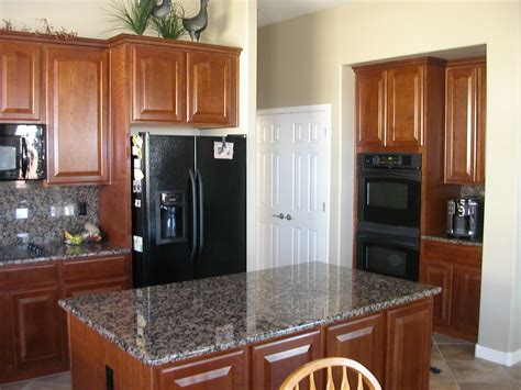 black stainless appliances with cherry cabinets this new kitchen s color is classic cherry with black