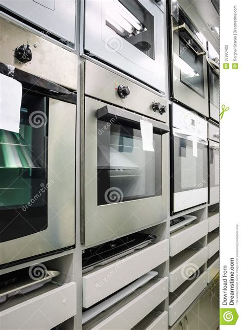 home appliance store row of ovens stock photography