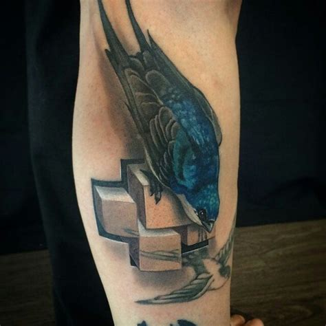 colored cross tattoos realism style colored leg of beautiful bird with