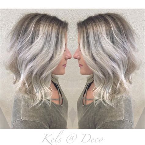 medium length dark hair with ash blonde platium high lights ice blonde balayage bob