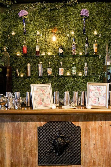 Picture Of a living wall as a bar backdrop and glass