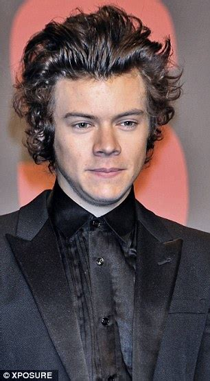 curly hair boys harry styles wiki harry styles tries hiding his famous curly hair under
