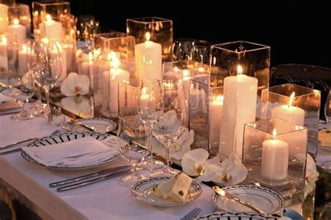 Candle Vase Wedding Centerpieces by Centerpieces With Candle Filled Hurricane Vases