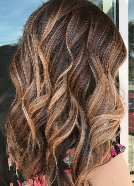 brunette hairstyles with caramel highlights caramel ribbons mane interest