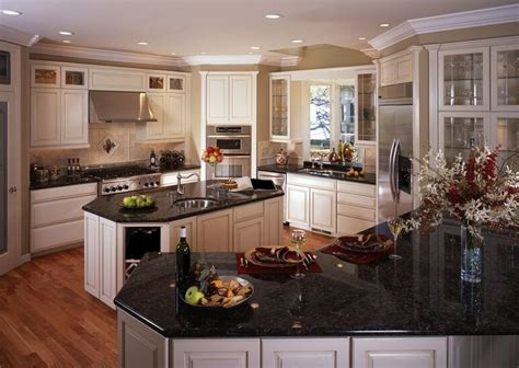 28 white kitchen cabinets with black granite