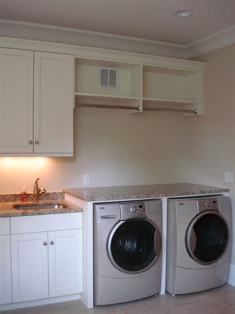 laundry room cabinets with hanging rod holz residence traditional laundry room
