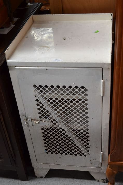 small metal food storage cabinet with vented doo