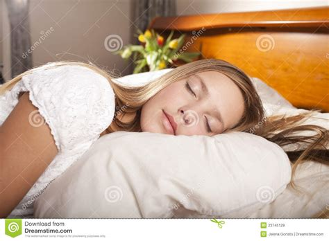 girl lying bed with flowers girl sleeping on the bed with flowers royalty free stock