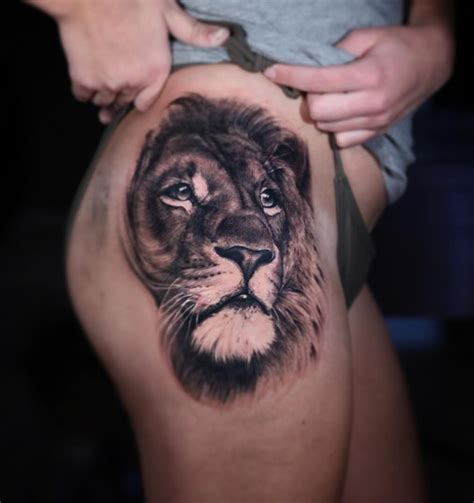 realistic lion on womans hip best tattoo design ideas