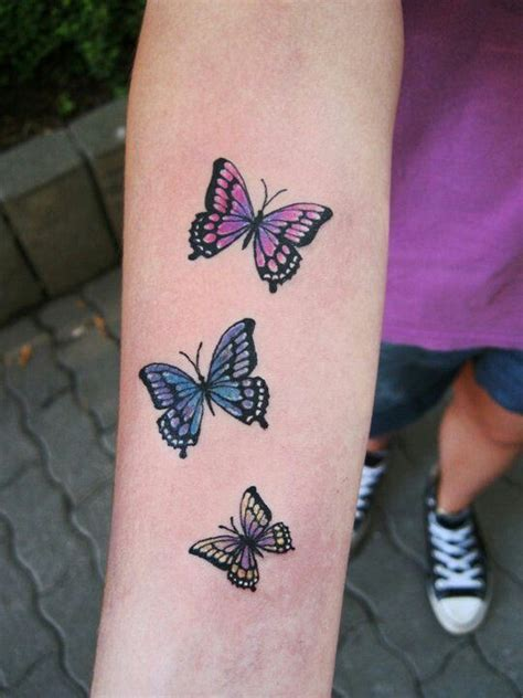 very small butterfly tattoos colorful small butterfly on arm
