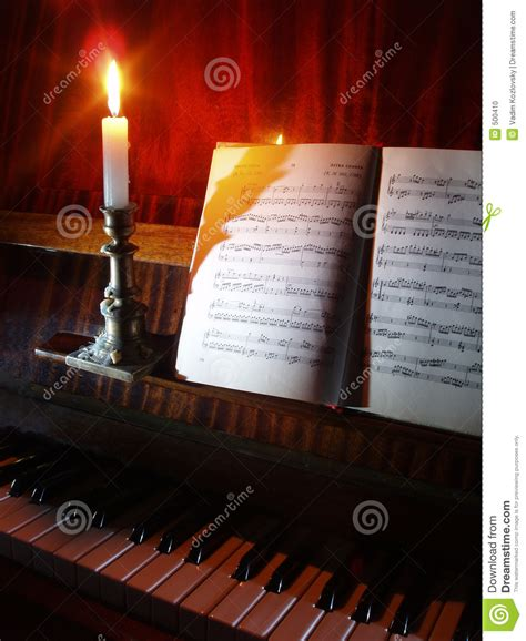 Candle Lighting Songs by Piano And Sheet In The Candle Lighting Stock Photo