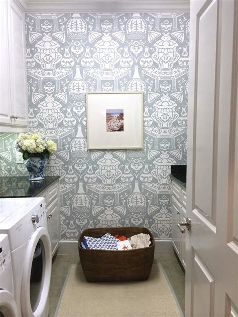 amy berry design beautiful laundry room features walls clad in david hicks
