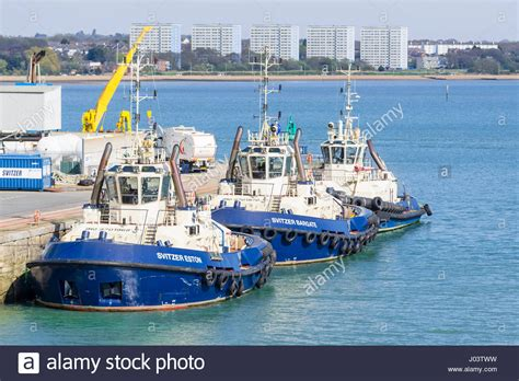 Tug Boat Shoppinf tug boats at sea 3 svitzer tugboats moored in port in the solent at stock photo royalty free