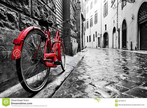 is black and white a color retro vintage bike on cobblestone in the