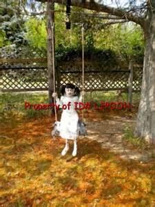 zombie girl swing animated prop lifesize animated demonic little zombie girl on swing