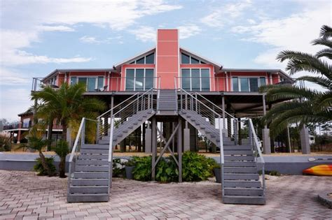 elevated hurricane proof home on pilings stilts