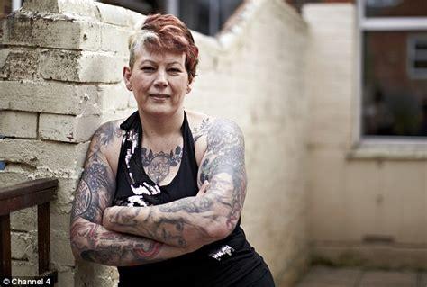 full body tattoo old woman supermarket worker 52 has tattoos of robert pattinson