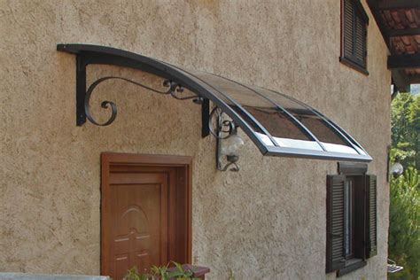 tettoie per portoni infissi porte in legno verande catania blindate pn