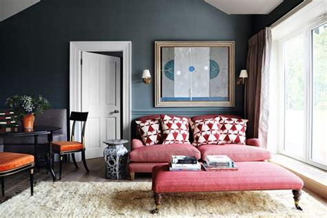 blue walls red couch red sofa with red ottoman living room ideas