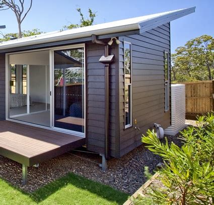 modern weatherboard house design idea with glasses home
